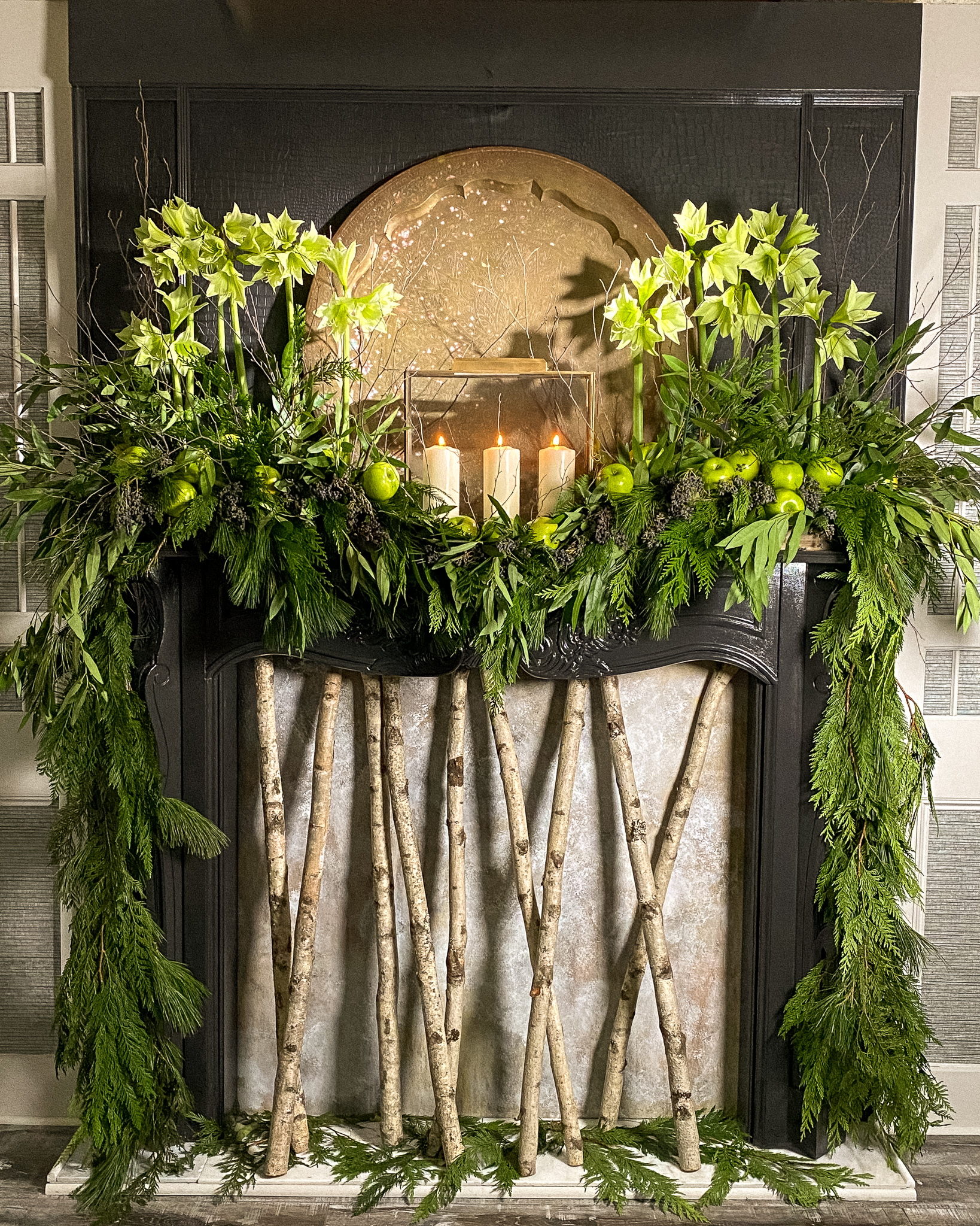 Green flowers and green apples on mantle with garlands to match